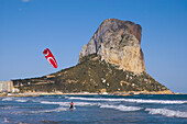 Spain. Alicante Province. Calpe. Penon de Ifach. Beach with kitesurfer