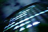 Architecture, Blurred, Building, Buildings, Business, Cities, City, Color, Colour, Concept, Concepts, Economy, Exterior, Facade, Façade, Facades, Façades, Horizontal, Lights, Low angle view, Night, Nighttime, Office, Offices, Outdoor, Outdoors, Outside,