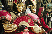 Adult, Adults, Carnival, Carnivals, Cities, City, Color, Colour, Costume, Costumed, Costumes, Daytime, Disguise, Disguises, Europe, Exterior, Festival, Festivals, Folk, Folklore, Group, Groups, Holiday, Holidays, Horizontal, Human, Italy, Mask, Masks, Ou