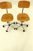Alike, Chair, Chairs, Color, Colour, Furniture, Indoor, Indoors, Inside, Interior, Object, Objects, Office chair, Office chairs, Office furniture, Pair, Same, Sameness, Thing, Things, Two, Two items, Vertical, View from above, Wood, Wooden, B19-214279, a