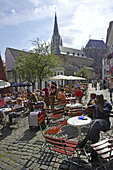 Open air cafes at Hof Square with reconstructed roman arches. Aachen, North Rhine-Westphalia, Germany