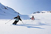 Two skiers downhill, Heliskiing, Kamchatka Peninsula, Sibiria, Russia