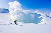 Two skiers near volcano Zhupanovsky, Heliskiing, Kamchatka Peninsula, Sibiria, Russia