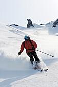 Heliskiing at Kamchatka, Sibiria, Russia, a man skis the powder