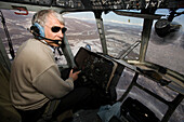 A helicopter pilot in the cockpit of a Russian MI-8 helicopter, Kamtchatka, Sibiria, Russia