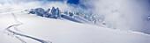 Ski track in deep snow at Mutnovsky Glacier, heliskiing in Kamchatka, Sibiria, Russia