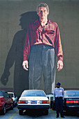 Mural by Ken Mitchell (painted frescoe on a wall) in a downtown parking lot, Los Angeles. California, USA