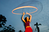 Dark-haired, Dusk, Exterior, Female, Fun, Girl, Girls, Grin, Grinning, Horizontal, Hula hoop, Hula h