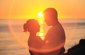 Adult, Adults, Affection, Attraction, Back-light, Backlight, Color, Colour, Contemporary, Couple, Couples, Daytime, Embrace, Embracing, Exterior, Female, Fondness, Heat, Horizon, Horizons, Horizontal, Hug, Hugging, Human, In love, Light, Look, Looking, L