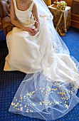 Adult, Adults, Anonymous, Bride, Brides, Color, Colour, Contemporary, Daytime, Delicate, Dress, Dressed up, Dresses, Elegance, Elegant, Female, Human, Indoor, Indoors, Inside, Interior, One, One person, People, Person, Persons, Room, Rooms, Seated, Singl