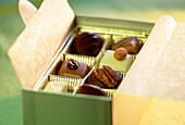 Box, Boxes, Chocolate, Chocolates, Close up, Close-up, Closeup, Color, Colour, Concept, Concepts, Different, Elegance, Elegant, Horizontal, Indoor, Indoors, Inside, Interior, Open, Still life, Sweet, Tempt, Temptation, Temptations, Tempting, Varied, Vari