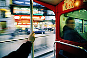 Activity, Anonymous, Bar, Bars, Blurred, Bus, Buses, Busses, Cities, City, Coach, Coaches, Color, Colour, Daytime, England, Europe, Exterior, Great Britain, Hold on, Holding, Holding on, Horizontal, Human, London, Motion, Movement, Moving, Outdoor, Outdo