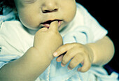 0 to 6 months, 0-6 months, 1 to 6 months, 1-6 months, 7 to 12 months, 7-12 months, Babies, Baby, Child, Childhood, Children, Color, Colour, Contemporary, Dentition, Detail, Details, Finger, Fingers, Gesture, Gestures, Gesturing, Hand, Hands, Horizontal,
