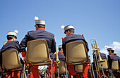 Adult, Adults, Back view, Brass, Break, Break-time, Breaks, Celebrate, Celebrating, Celebration, Celebrations, Chair, Chairs, Chat, Chatting, Color, Colour, Contemporary, Costume, Costumes, Daytime, Exterior, Festival, Festivals, Holiday, Holidays, Horiz