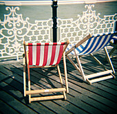 Beach, Beach chair, Beach chairs, Beaches, Blue, Calm, Calmness, Coast, Coastal, Color, Colour, Daytime, Deck chair, Deckchair, Empty, Exterior, Holiday, Holidays, Leisure, Outdoor, Outdoors, Outside, Pair, Peaceful, Peacefulness, Quiet, Quietness, Rail,