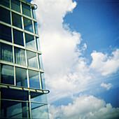 Architecture, Building, Buildings, Cities, City, Cloud, Clouds, Color, Colour, Contrast, Contrasts, Daytime, Exterior, Facade, Façade, Facades, Façades, Floor, Floors, Glass, Half, Halves, Height, Modern, Outdoor, Outdoors, Outside, Skies, Sky, Special e