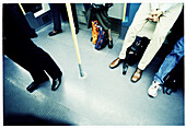 Adult, Adults, Anonymous, Bar, Bars, Color, Colour, Contemporary, Floor, Floors, Horizontal, Human, Indoor, Indoors, Inside, Interior, Leg, Legs, Passenger, Passengers, People, Person, Persons, Public transport, Public transportation, Subway, Subway car,