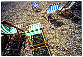 Absence, Absent, Beach, Beach chair, Beach chairs, Beaches, Calm, Calmness, Chill out, Chilling out, Color, Colour, Concept, Concepts, Daytime, Deck chair, Deckchair, Empty, Exterior, Holiday, Holidays, Horizontal, Leisure, Outdoor, Outdoors, Outside, Pea