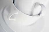 Close up, Close-up, Closeup, Color, Colour, Concept, Concepts, Cup, Cups, Detail, Details, Empty, Handle, Handles, Heap, Heaped, Indoor, Indoors, Inside, Interior, Object, Objects, Pile, Piled up, Piles, Saucer, Saucers, Selective focus, Stack, Stacked,
