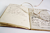 Accessories, Accessory, Aged, Aid, Book, Books, Close up, Close-up, Closeup, Color, Colour, Concept, Concepts, Detail, Details, Eyeglasses, Gastronomy, Glass, Glasses, Grandmother, Grandmothers, Grandparent, Handwritten, Health, Health care, Healthcare,