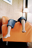 Anonymous, Armchair, Armchairs, At home, Barefeet, Barefoot, Child, Children, Chill out, Chilling out, Color, Colour, Contemporary, Daytime, Feet, Foot, Furniture, Holiday, Holidays, Home, Human, Indoor, Indoors, Inside, Interior, Kid, Kids, Leg, Legs, L