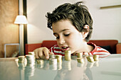 Boy, Boys, Cash, Caucasian, Caucasians, Child, Childhood, Children, Coin, Coins, Color, Colour, Contemporary, Count, Counting, Counts, Economy, Facial expression, Facial expressions, Glass, Grin, Grinning, Heap, Heaped, Heaps, Human, Indoor, Indoors, Inf