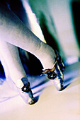 Color, Colour, Concept, Concepts, Doll, Dolls, Feet, Foot, Footgear, Footwear, Luxurious, Luxury, Old fashioned, Old-fashioned, Shoe, Shoes, Tiptoe, Tiptoeing, Upscale, B75-478906, agefotostock