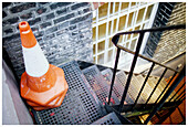 Accessibility, Bollard, Bollards, Cities, City, Color, Colour, Concept, Concepts, Cone, Cones, Corner, Corners, Daytime, Exterior, Fire escape, Heap, Heaped, Obstacle, Obstacles, Out of place, Outdoor, Outdoors, Outside, Pile, Piled up, Piles, Stack, Sta