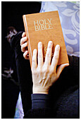 Adult, Adults, Bible, Bibles, Christian, Christianity, Close up, Close-up, Closed, Closeup, Color, Colour, Contemporary, Detail, Details, English, Faith, Hand, Hands, Holy Bible, Holy book, Holy books, Human, Indoor, Indoors, Interior, One, One person, P