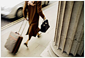 Adult, Adults, Bag, Baggage, Bags, Blurred, Business, Business travel, Business trip, Businesspeople, Businessperson, Businesswoman, Businesswomen, Carry, Carrying, Color, Colour, Column, Columns, Contemporary, Corporate, Daytime, Determination, Economy,