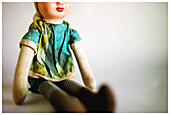 Childhood, Close up, Close-up, Closeup, Color, Colour, Concept, Concepts, Doll, Dolls, Indoor, Indoors, Infantile, Interior, Object, Objects, One, One item, Seated, Selective focus, Sit, Sitting, Thing, Things, Toy, Toys, B75-499520, agefotostock