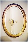Color, Colour, Communication, Communications, Concept, Concepts, Corner, Corners, Daytime, Decoration, Golden, Indoor, Indoors, Interior, Mirror, Mirror image, Mirror images, Mirrors, Phone, Phones, Reflection, Reflections, Room, Rooms, Telecommunication