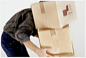 Action, Activity, Adult, Adults, Box, Boxes, Cardboard, Carry, Carrying, Color, Colour, Contemporary, Courier, Couriers, Employee, Employees, Human, Indoor, Indoors, Interior, Male, Man, Men, Messenger, Messengers, Move home, Moving home, One, One person