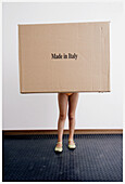Box, Boxes, Child, Children, Color, Colour, Commerce, Contemporary, Female, Full-body, Full-length, Girl, Girls, Human, Import, Imports, Indoor, Indoors, Interior, Kids, Leg, Legs, Made in Italy, Odd, One, One person, Package, Packages, Parcel, Parcels,