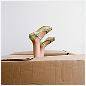 Amusing, Box, Boxes, Child, Children, Color, Colour, Contemporary, Feet, Female, Foot, Funny, Girl, Girls, Human, Indoor, Indoors, Interior, Kids, Odd, One, One person, Package, Packages, Parcel, Parcels, People, Person, Persons, Shoe, Shoes, Single pers