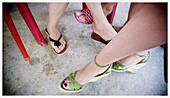Accessories, Accessory, Adult, Adults, Color, Colour, Contemporary, Daytime, Detail, Details, Different, Exterior, Feet, Female, Foot, Footgear, Footwear, Ground, Grounds, Human, Outdoor, Outdoors, Outside, People, Person, Persons, Sandal, Sandals, Shoe,