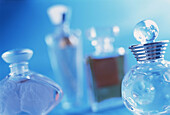 Aroma, Aromas, Blue, Bottle, Bottles, Close up, Close-up, Closeup, Color, Colour, Concept, Concepts, Elegance, Elegant, Feminine, Fragrance, Horizontal, Indoor, Indoors, Interior, Object, Objects, Odor, Odors, Odour, Odours, Perfume, Perfumery, Perfumes,