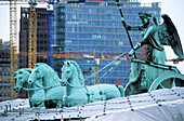 Brandenburg Gate, detail of the Quadriga restoration works with Potsdamer Platz buildings in background. Berlin. Germany
