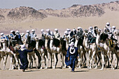 Tuareg riders gathering for the race start at the annual Sebiba camel race. Djanet Oasis. Tassili n Ajjer. Sahara. South Algeria