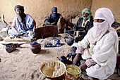 Gathering in the tuareg village of Ideles (Hoggar mountains) to share tea with visitors. South Algeria