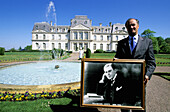 Hotel Manager Mr Puvilland holding a photograph of Francois Coty and chef in Chateau d Artigny Hotel. Touraine (Chateaux country). Val-de-Loire. France