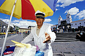 Ice cream seller under a colored umbrella. Plaza de San Francisco. Quito. Ecuador