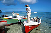 Local small fishing boats delivering fish to the market. Trou Aux Biches Beach. Mauritius