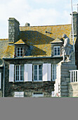 Old granite stone house and War Memorial. Barfleur. Manche. Normandy. France