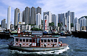 Aberdeen skyline and chinese boats at fore. Hong Kong. China