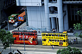 Elevated view on two trams with ad painted on. Wanchai, Hong Kong. China
