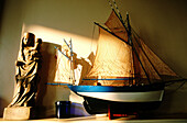 Scale model of local ancient fishing boat and Virgin statue. Cancale. Ille-et-Villaine. Brittany. France