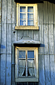 North facade of a traditional house protected from the strong winter winds. Jura. Bois d Amont. Doubs. Franche-Comte. France
