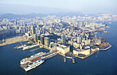 Aerial of Kowloon and liners quay on left. Hong Kong. China