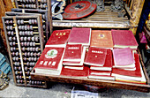 Abacus and used Mao Ze Dong s little red books at Dongtai Road antiques market. Shanghai. China